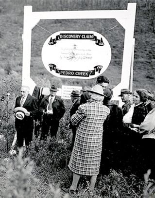 Pioneers gather around the first Pedro Discovery marker at its dedication.
