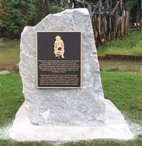 Granite rock with a brass plaque honors the prospectors of the Tanana Valley.