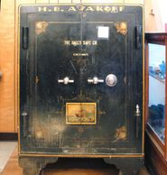 Large, heavy metal safe with wheels.