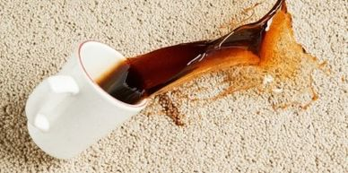cup of coffee spilling on clean, white carpet