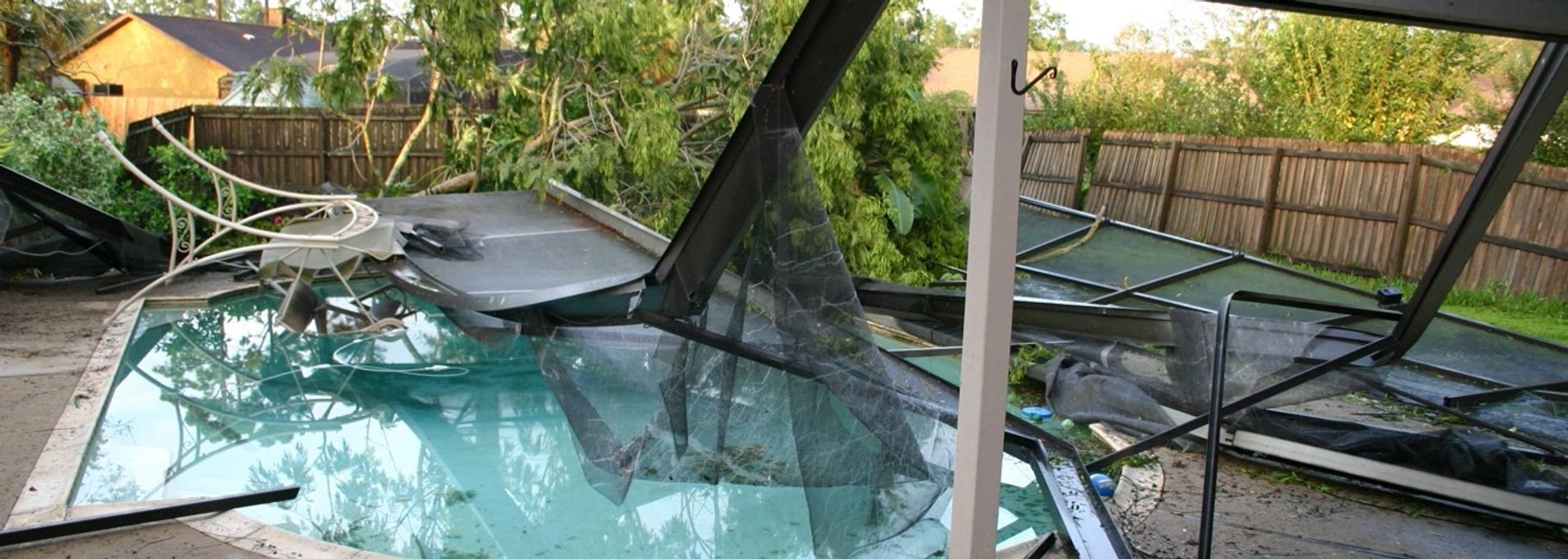 hurricane knocked pool cage over and trees