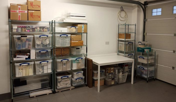 De-cluttered Garage, Storage boxes, Keep it simple. Organised business area.