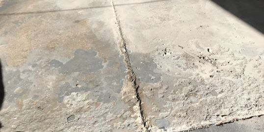 WORN OUT CONCRETE FLOOR
