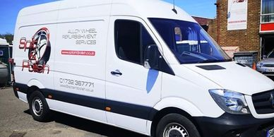 Spit and polish sprinter van outside business