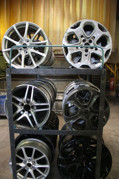 Unfinished alloy wheels ready to be refurbished at Spit and Polish