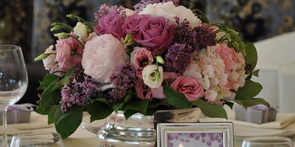Romantic wedding centerpiece with peonies, lilac, roses, lysianthus and hydrangea