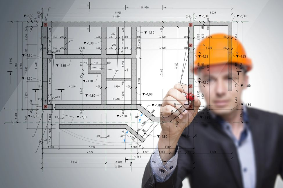Project Engineer inspecting & drawing a site diagram