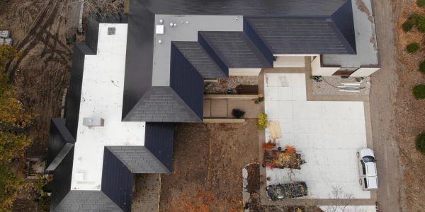 Integrated Solar panels into a metal roof are better than solar roof tiles by Tesla