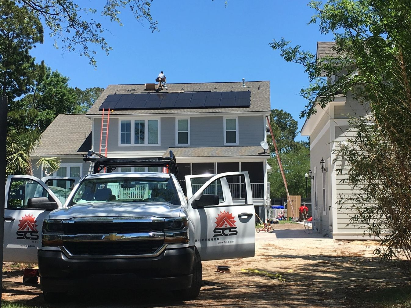 South Carolina Solar installing a roof top solar energy system with LG solar lanels