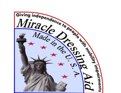 Photo of the logo badge of the Miracle Dressing Aid