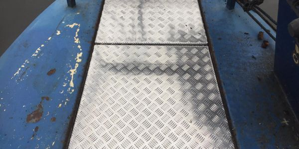 Aluminium Chequer plate decks and engine covers.