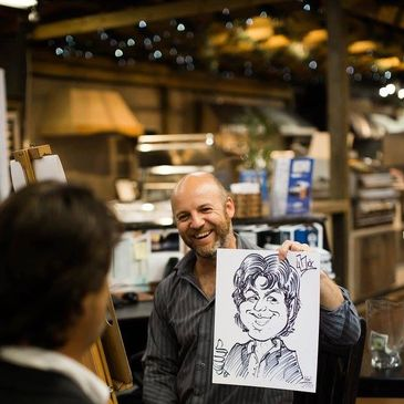 A picture of Rafael Diaz with a caricature he drew.