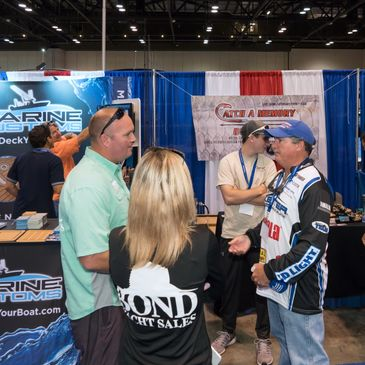 A picture of Capt. Jim Ross in his booth at the Orlando Boat Show.
