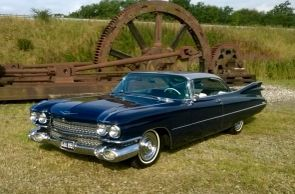 Classic Cadillac styling, resplendent in blue with silver roof.