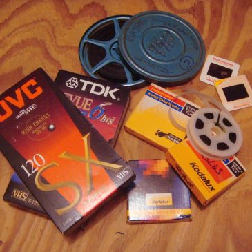 film reels, vhs tapes and slides