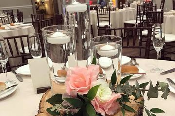Wood slab, trio cylinders with floating candles, custom floral.