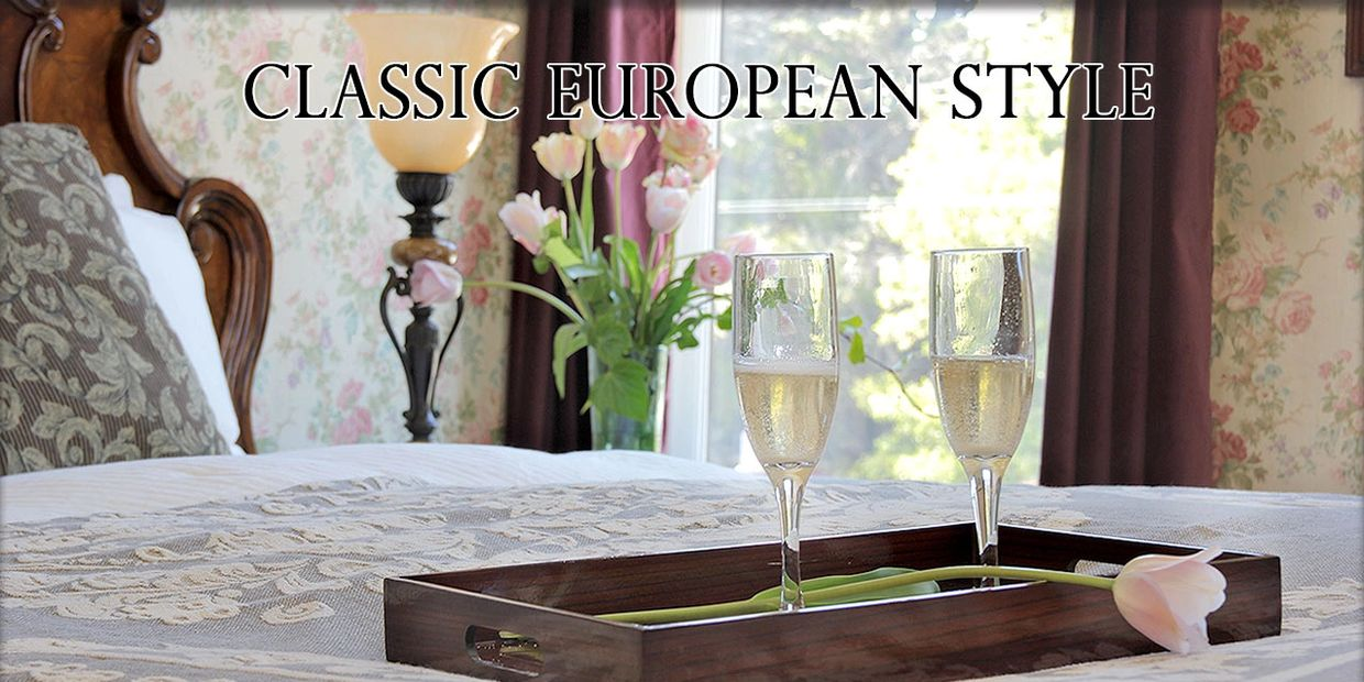 Classic European Style. Champagne flutes and flower.