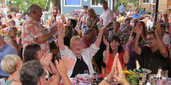 Happy Auction Bidders at the Vine Village Annual Celebration