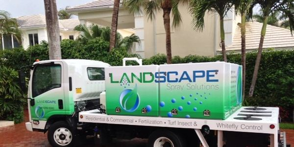 The truck of a landscape pest control in Delray Beach, FL