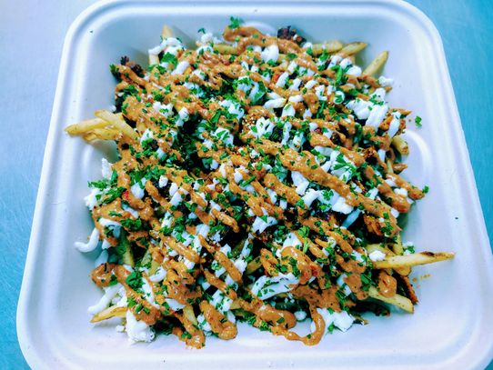 Loaded Shawarma Fries! Choose Chicken or Cauliflower, comes with Toum, Muhammara, Feta, and Parsley