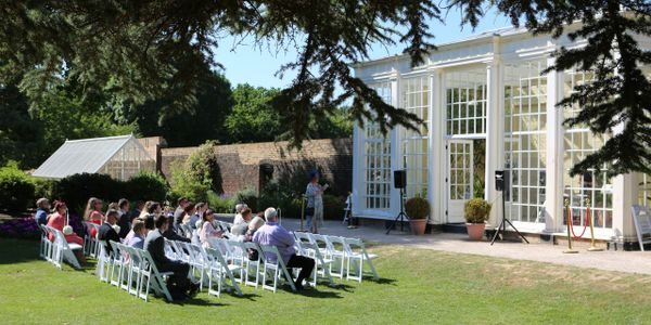 guests sitting outside the orangery