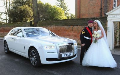 soldier and bride next to Rolls Royce