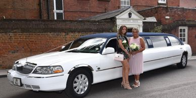 mother and daughter next to limousine