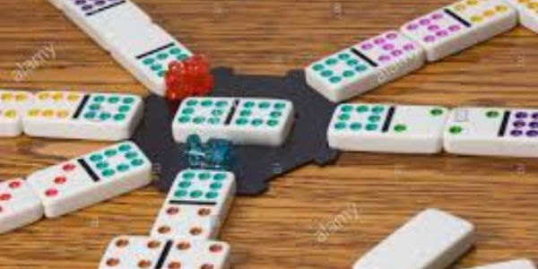 Dominoes and other board games are available for play at Vientos Bajos.