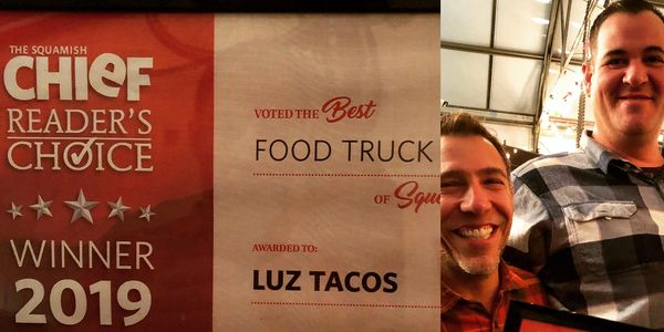 Award for Luz Tacos voted best food truck in Squamish at the Chief Newspaper. Owners holding diploma