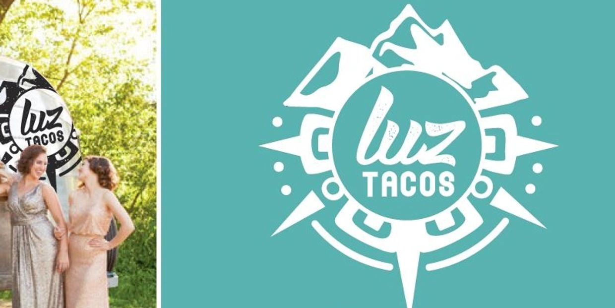 Luz Tacos Mexican food trailer catering a wedding or private event with guest standing nearby.