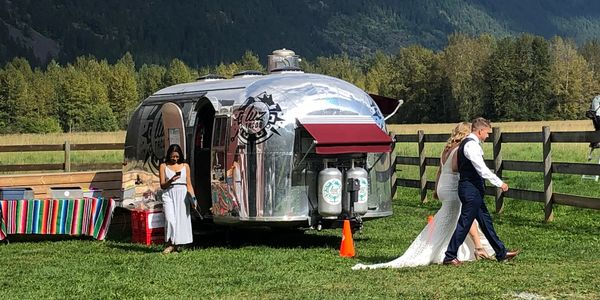 Luz Tacos is catering a wedding, bride and groom walking to their ceremony, airstream trailer near