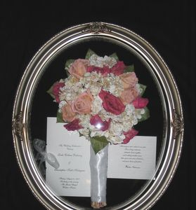 Freeze dried wedding flowers preserved and mounted in a bubble frame for a lasting keepsake.