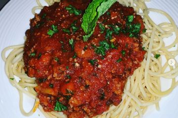 Spaghetti pasta topped with our homemade Bolognese meat sauce
