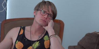 "Kyle Rezzarday props his head in his hand, looking dejected in a screen grab from ""Pretty Dudes."""