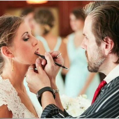 Makeup Artist, Skin Care Specialist, Beauty Expert & Aesthetician Jamie Angeles, of Angeles Beauty Arts - applying lip color to a  bride, on-site at her wedding