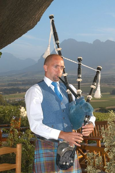 The Sussex Bagpiper playing in Paarl, South Africa