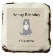 "This Rattles' birthday brownie design is inspired by the book series, ""Rattles, the Barn Cat."""
