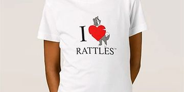 "The design on this t-shirt is inspired by the book series, ""Rattles, the Barn Cat."""