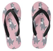"The design on these flip flops is inspired by the book series, ""Rattles, the Barn Cat."""