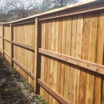 Redwood Top Cap Fence with pressure-treated 2x4 rails in El Dorado Hills, CA.