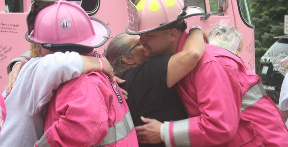 pink firefighters visiting cancer patients