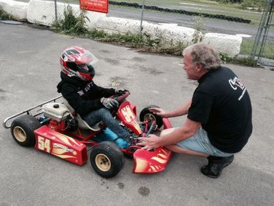 Young driver receiving instruction before taking an Arrive & Drive Kid-Kart out