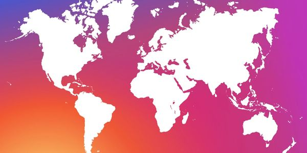 A world map with a pink, purple and orange background to signify social media marketing