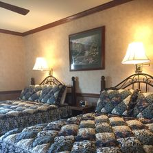 guest room with queen and double beds and beautiful puff quilts