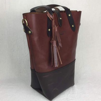 Leather tote made from oil tanned leather with solid brass saddle rivets and brass D-rings.