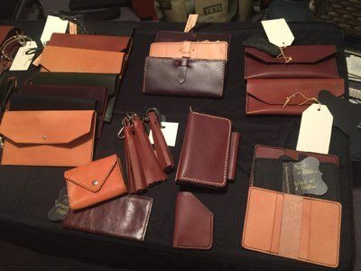 Handcrafted leather wallets, clutches, cross-body bags. Bespoke leather goods from North Carolina.