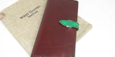 """The Charlotte"" Women's Wallet, has 12 card slots and 2 large slots for notes/bills. Folds in half."