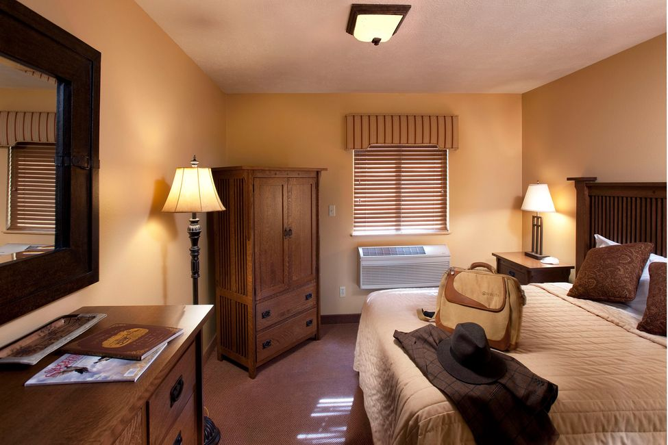 Single-occupancy guest rooms at The Signature Lodge.