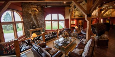 The Signature Lodge Great Room is the perfect place to relax on the sofas in front of the fireplace.