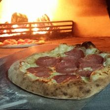 wood fired pizza cooked in a clay oven